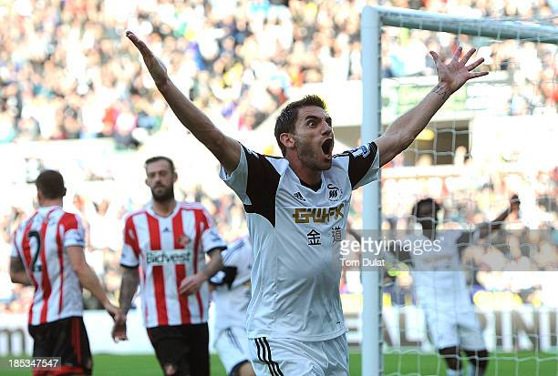 Angel Rangel of Swansea City celebrates his goal during the Barclays Premier League match between Swansea City and Sunderland at Liberty Stadium on...