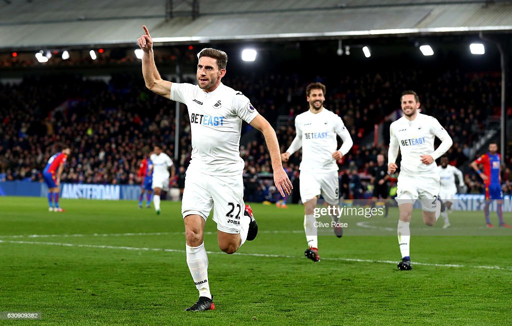 Angel Rangel (L) of Swansea City celebrates scoring his team's second goal during the Premier League match between Crystal Palace and Swansea City at Selhurst Park on January 3, 2017 in London, England.