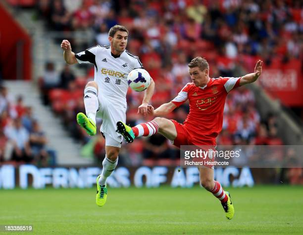 Angel Rangel of Swansea City challenges Steven Davis of Southampton during the Barclays Premier League match between Southampton and Swansea City at...