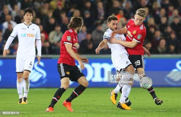 Angel Rangel of Swansea City is challenged by Scott McTominay of Manchester United during the Carabao Cup Fourth Round match between Swansea City and...