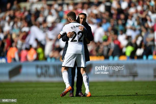 Angel Rangel of Swansea City is embraced by Carlos Carvalhal Manager of Swansea City after the Premier League match between Swansea City and Stoke...