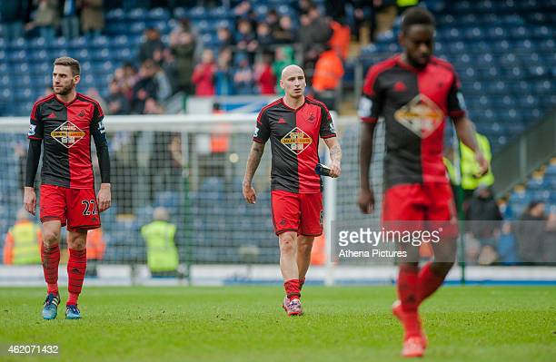 Angel Rangel of Swansea City Jonjo Shelvey of Swansea City and Nathan Dyer of Swansea leave the field at the end of the match during the FA Cup...