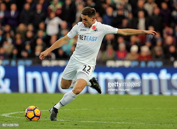 Angel Rangel of Swansea City passes the ball forward during the Premier League match between Swansea City and Manchester United at The Liberty...