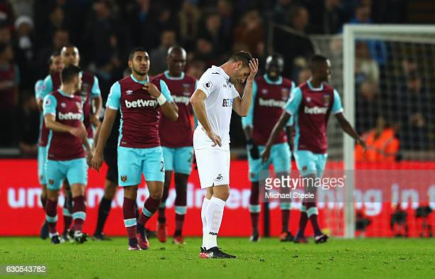 Angel Rangel of Swansea City reacts after the fourth West Ham goal during the Premier League match between Swansea City and West Ham United at...