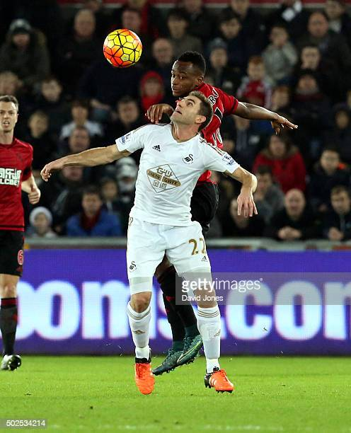 Angel Rangel of Swansea City Saido Berahino of West Bromwich Albion during the Barclay's Premier League match between Swansea City v West Bromwich...