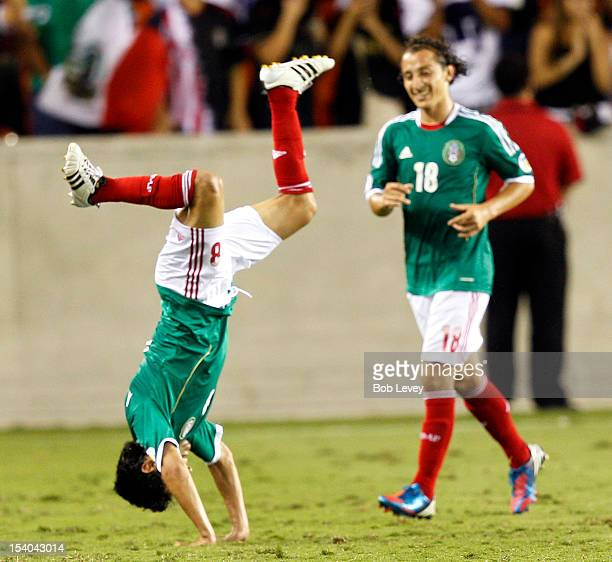 Angel Reyna of Mexico does a flip after scoring against Guyana at BBVA Compass Stadium on October 12 2012 in Houston Texas Mexico defeated Guyana 50