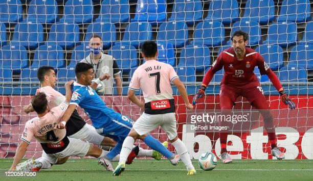 Angel Rodriguez of FC Getafe Victor Sanchez of Espanyol Barcelona Wu Lei of Espanyol Barcelona and Diego Lopez of Espanyol Barcelona battle for the...