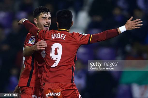 Angel Rodriguez of Getafe CF celebrates after scoring his team's first goal with his teammate Hugo Duro during the Copa del Rey Round of 16 match...