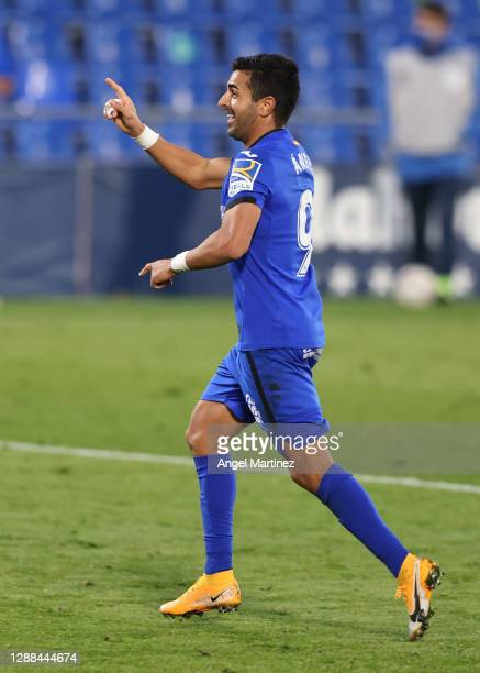Angel Rodriguez of Getafe CF celebrates after scoring their sides first goal during the La Liga Santander match between Getafe CF and Athletic Club...