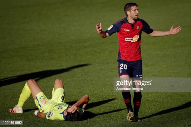 Angel Rodriguez of Getafe Darko Brasanac of Osasuna during the La Liga Santander match between Osasuna v Getafe at the Estadio El Sadar on July 5...