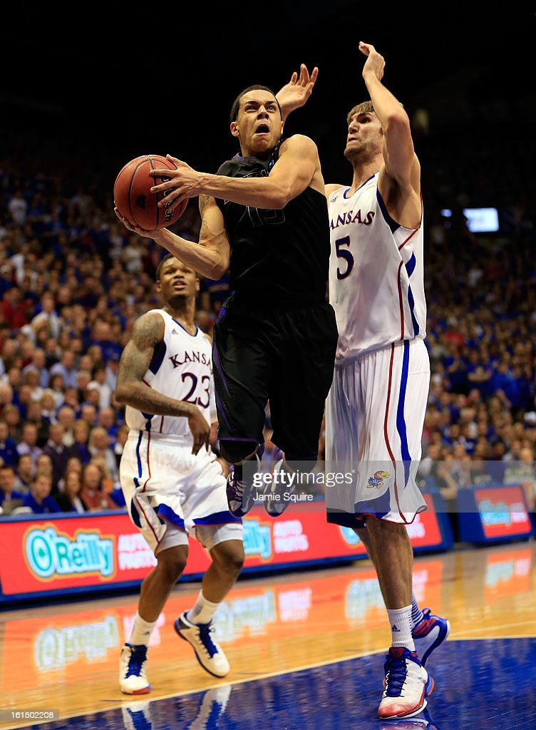 Angel Rodriguez #13 of the Kansas State Wildcats drives to the basket as Ben McLemore #23 and Jeff Withey #5 of the Kansas Jayhawks defend during the game at Allen Fieldhouse on February 11, 2013 in Lawrence, Kansas.