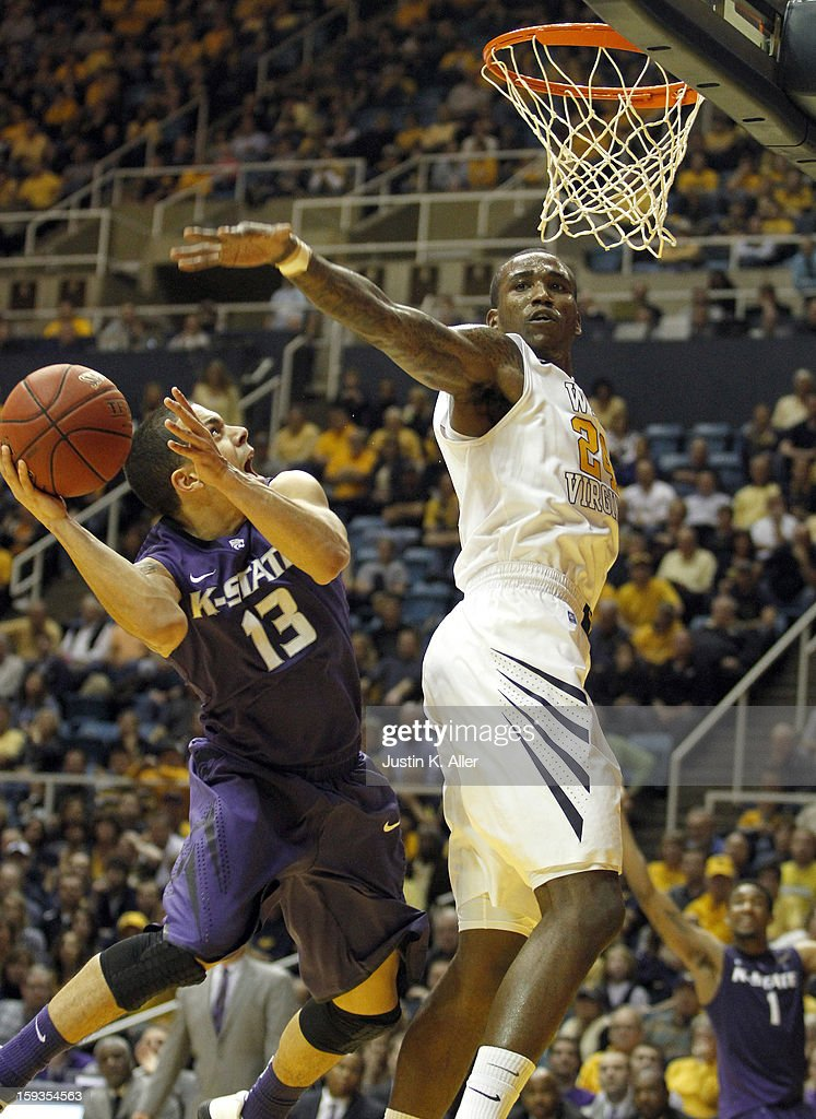 Angel Rodriguez #13 of the Kansas State Wildcats drives to the basket against Aaric Murray #24 of the West Virginia Mountaineers at the WVU Coliseum on January 12, 2013 in Morgantown, West Virginia. Kansas State defeated West Virginia 65-64.