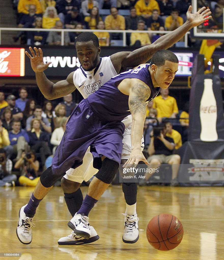 Angel Rodriguez #13 of the Kansas State Wildcats maneuvers around Jabarie Hinds #4 of the West Virginia Mountaineers at the WVU Coliseum on January 12, 2013 in Morgantown, West Virginia. Kansas State defeated West Virginia 65-64.