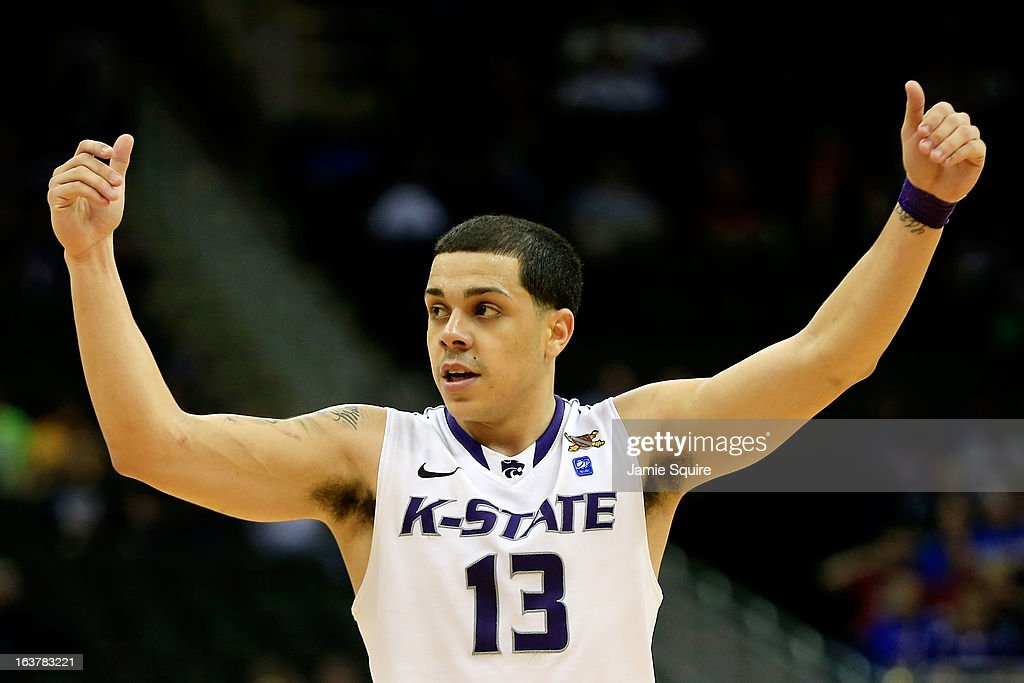 Angel Rodriguez #13 of the Kansas State Wildcats reacts against the Oklahoma State Cowboys in the second half during the Semifinals of the Big 12 basketball tournament at the Sprint Center on March 15, 2013 in Kansas City, Missouri.