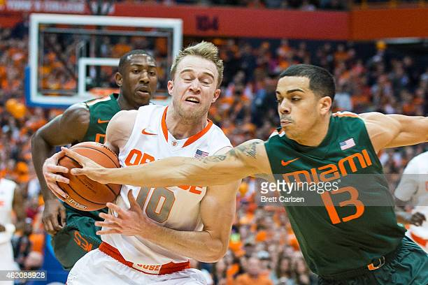 Angel Rodriguez of the Miami Hurricanes attempts to stop a breakaway by Trevor Cooney of the Syracuse Orange during the first half on January 24 2015...