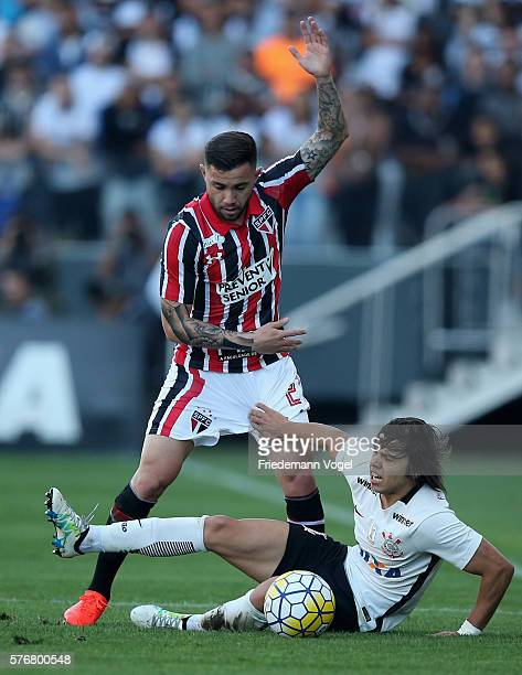 Angel Romero of Corinthians fights for the ball with Mena of Sao Paulo during the match between Corinthians and Sao Paulo for the Brazilian Series A...