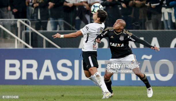 Angel Romero of Corinthians vies for the ball with Nino Paraba of Ponte Preta during the match between Corinthians and Ponte Preta for the...