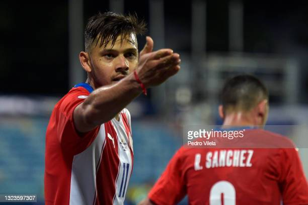 Angel Romero of Paraguay celebrates after scoring the second goal of his team during a Group A match between Paraguay and Bolivia at Estádio Olímpico...