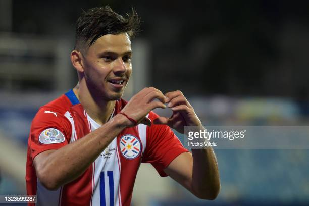 Angel Romero of Paraguay celebrates after scoring the third goal of his team during a Group A match between Paraguay and Bolivia at Estádio Olímpico...