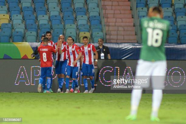 Angel Romero of Paraguay celebrates with teammates after scoring the second goal of his team during a Group A match between Paraguay and Bolivia at...