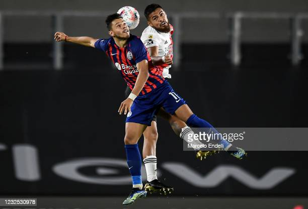 Angel Romero of San Lorenzo jumps for the ball with Paulo Diaz of River Plate during a match between River Plate and San Lorenzo as part of Copa de...