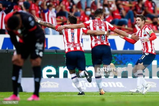Angel Saldívar of Chivas celebrates with his teammates after scoring the first goal of his team during the 16th round match between Atlas and Chivas...