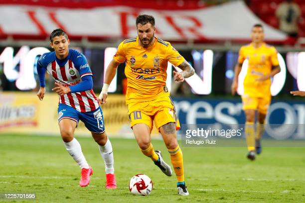 Angel Saldívar of Chivas fights for the ball with Andre-pierre Gignac of Tigres during the match between Chivas and Tigres UANL as part of the...
