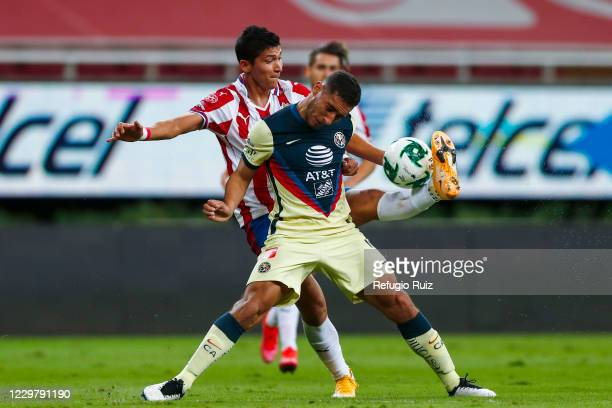 Angel Saldívar of Chivas fights for the ball with Sebastián Cáceres of America during the quarterfinals first leg match between Chivas and America as...