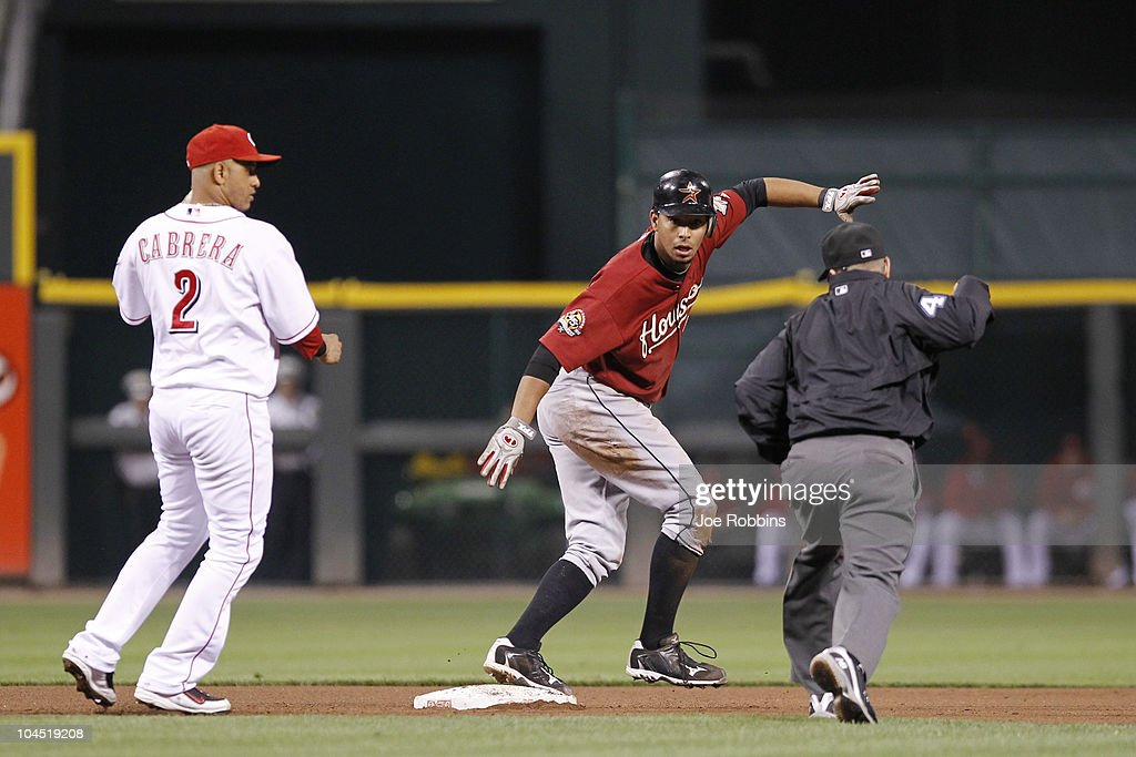 Angel Sanchez #36 of the Houston Astros looks at second base umpire Jerry Meals after being tagged out by Orlando Cabrera #2 of the Cincinnati Reds at Great American Ball Park on September 28, 2010 in Cincinnati, Ohio. The Reds won 3-2 to clinch the NL Central Division title.