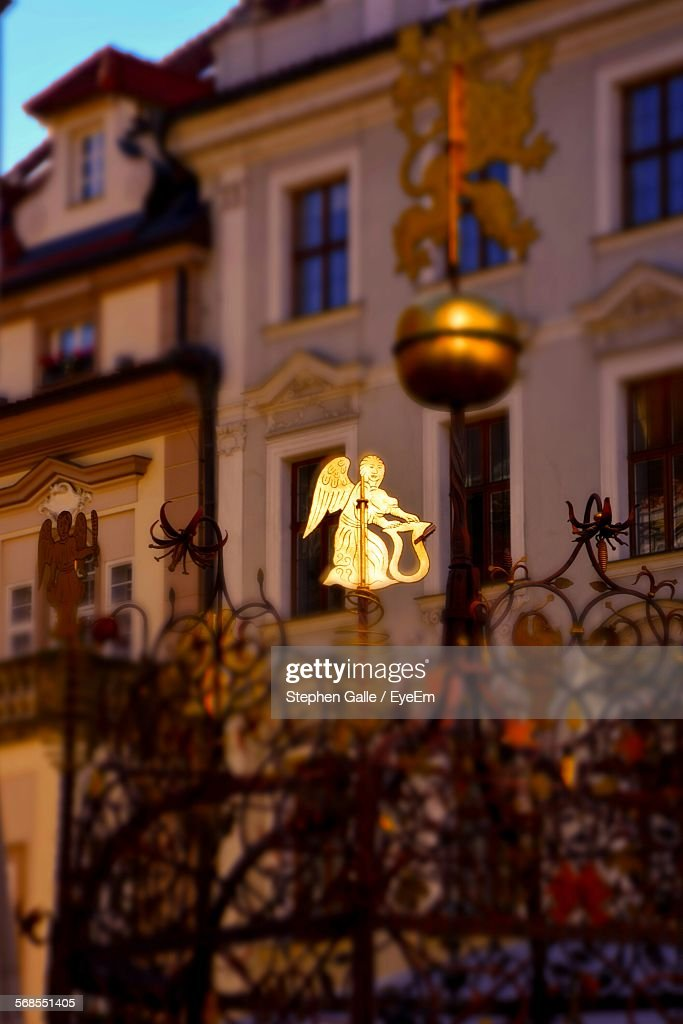 Angel Sculpture By Fountain In Front Of Building : Stock Photo