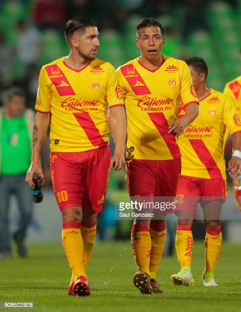 Angel Sepulveda and Diego Valdes of Morelia leave the field at the end of the first half during the 3rd round match between Santos Laguna and Morelia...
