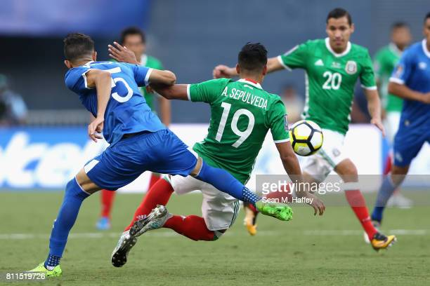 Angel Sepulveda of Mexico is tripped by Ivan Macia of El Salvador during the first half of a 2017 CONCACAF Gold Cup Group C match at Qualcomm Stadium...