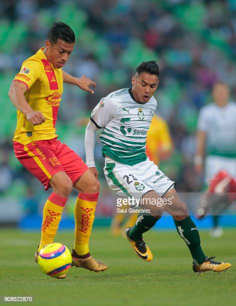 Angel Sepulveda of Morelia and Jose Vazquez of Santos fight for the ball during the 3rd round match between Santos Laguna and Morelia as part of the...