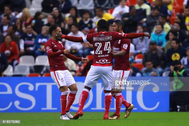 Angel Sepulveda of Morelia celebrates with teammates after scoring the first goal of his team during the 7th round match between America and Monarcas...