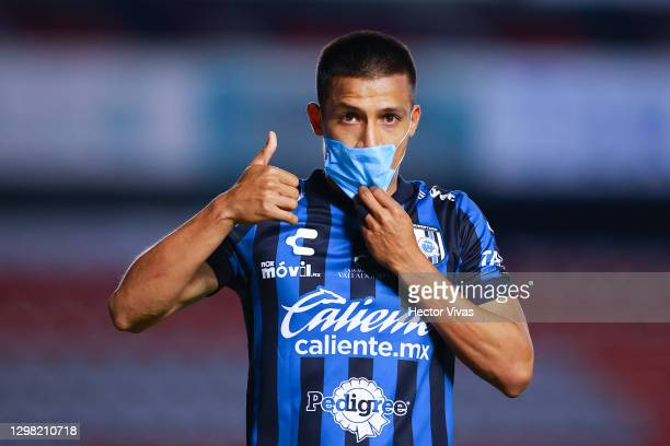 Angel Sepulveda of Queretaro celebrates putting a face mask after scoring the second goal of his team during the 3rd round match between Queretaro...