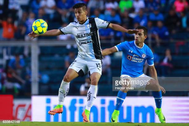 Angel Sepulveda of Queretaro struggles for the ball with Adrian Aldrete of Cruz Azul during the 5th round match between Cruz Azul and Queretaro as...