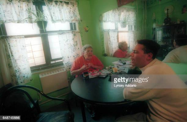Angel sits with his mother at a table inside the Harlem projects in New York City in November 1999 Angel's mother is aware that her son dresses as a...