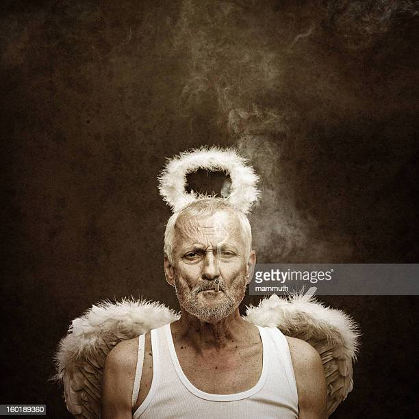 angel smoking cigarette - male angel stock photos and pictures