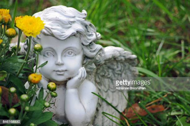 angel statue, close-up, in grass - cherub stock pictures, royalty-free photos & images