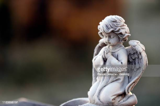 angel statue in winter.  cemetery.  lundamo. norway. - angel stock pictures, royalty-free photos & images