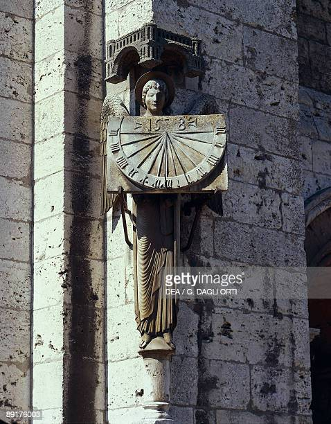 Angel statue on the wall of a cathedral Notre Dame Chartres France