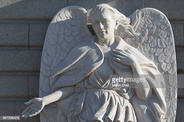 angel statue outside the cathedral in madrid - royal cathedral stock pictures, royalty-free photos & images