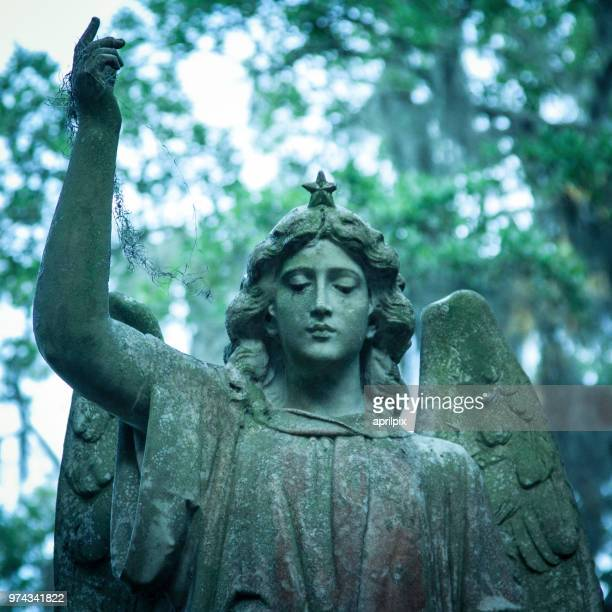 Angel statue with raised arm, Savannah, Georgia, USA