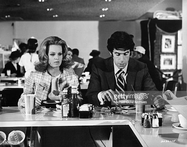 Angel Tompkins and Elliott Gould at diner together in a scene from the film 'I Love My Wife' 1970
