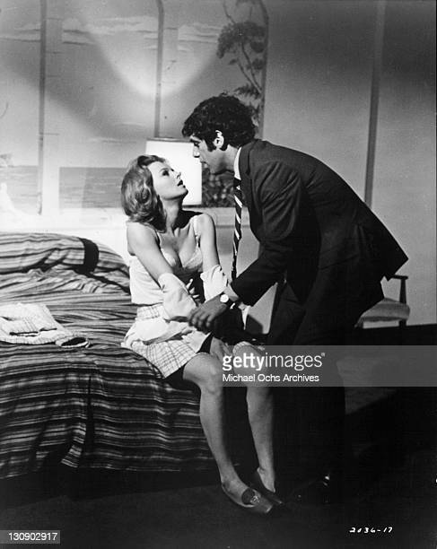 Angel Tompkins is undressed by Elliott Gould in a scene from the film 'I Love My Wife' 1970