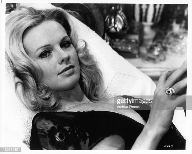 Angel Tompkins laying back in a scene from the film 'Prime Cut' 1972