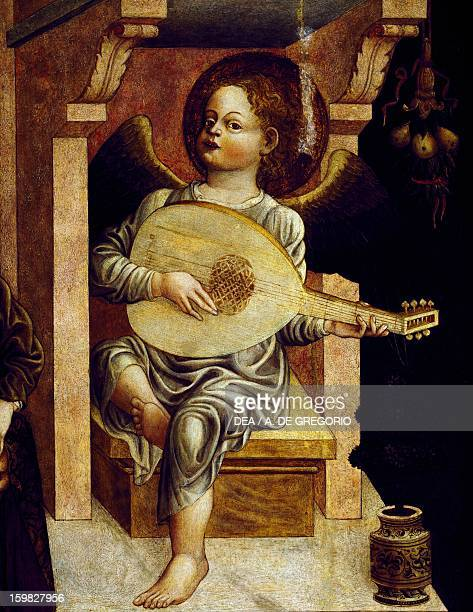 Angel with a musical instrument detail from Madonna and Child enthroned with angels making music and God the Father by Jacopo d'Ilario Loschi table...