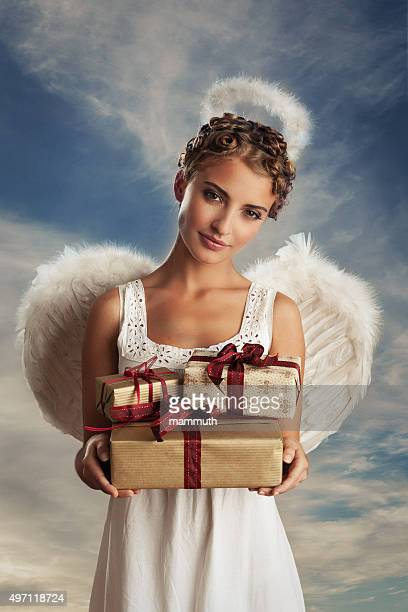 angel with gifts - catholic church christmas stock photos and pictures