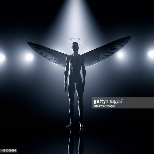 Angel with wings and halo in a spotlight
