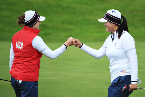 Angel Yin and Ally McDonald of Team USA react after winning the fourteenth hole during Day 2 of the Solheim Cup at Gleneagles on September 14 2019 in...